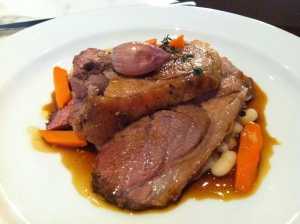 Rotisserie lamb with vegetables and beans